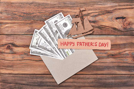 ship with gift: Greeting card, chipboard ship, money. Fathers Day card and dollars. Sea voyage as a gift.