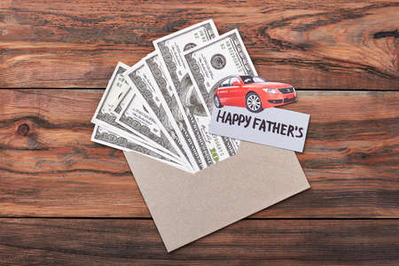 super dad: Fathers Day card and dollars. Paper car on envelope. Great present for super dad. Stock Photo