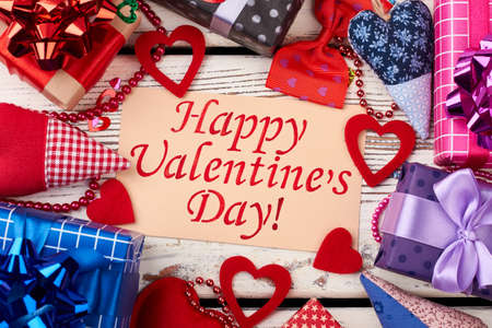 Valentines Day card and presents. Fabric hearts, bow, bead garland. How to decorate gifts.