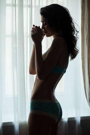 sip: Lady drinking from cup. Girl in panties near window. Sip of refreshing coffee.