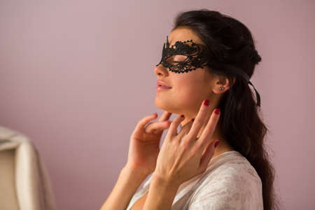 Lady wearing lace mask. Woman with closed eyes. Look gorgeous and charming. Stock Photo