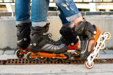 roller blade: Legs wearing roller blade. Black and orange inline skates. Improved materials and new design. Stock Photo