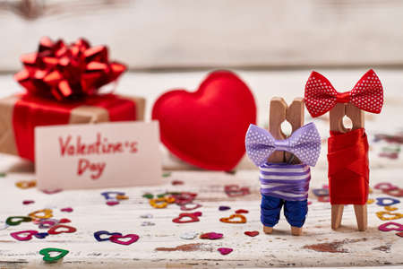 Clothespin couple and gift box. Red heart for Valentines Day. Being always together.