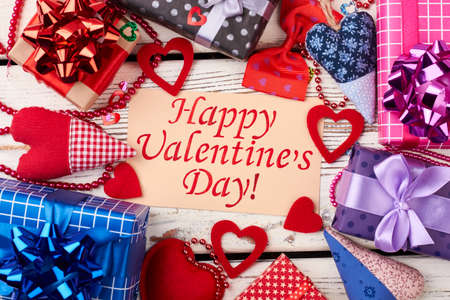 Fabric hearts and gift boxes. Greeting paper and bead garland. Ideas of Valentines Day celebration.