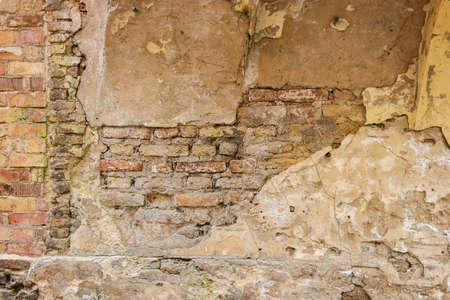 merciless: Old bricks and concrete. Aged wall surface. Time is merciless. Stock Photo