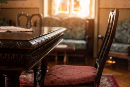 Antique table and chair. Classic room interior. Victorian furniture for sale.  Stock Photo - Antique Table And Chair. Classic Room Interior. Victorian Furniture