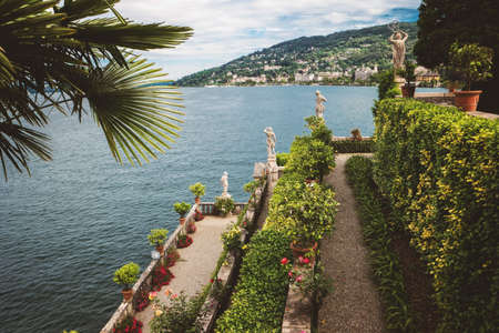 Green plants and statues. Buildings on green mountain. View from Isola Bella. Stock Photo