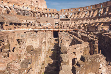 Inner part of Colosseum. People in old building. Historic landmark of Rome.