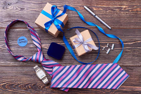 Tie and watch for father. Greeting card and pen. Classic accessories as gift. Stock Photo