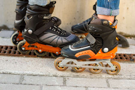 durable: Legs in rollerblades. Inline skates and asphalt. Durable materials and new design.