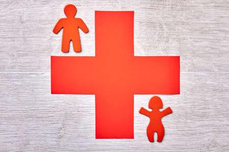 stickmen: Cross and stickmen on light background. Advertisement of a new clinic.