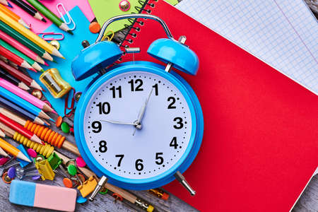 memo: Alarm clock and notebook. Start your day productively. Stock Photo