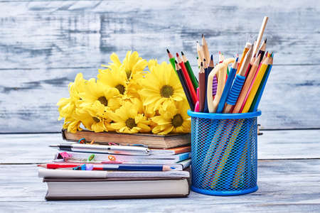 Flowers, stationery and copybooks. Knowledge is a treasure.
