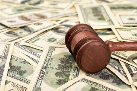 Chairman hammer and dollar bills. Court case on bribery. Stock Photo