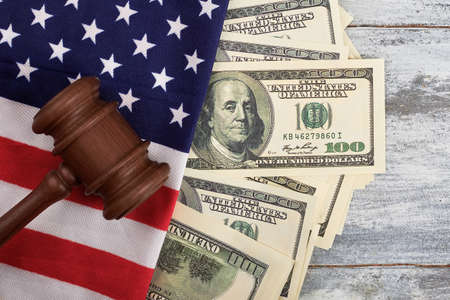 Gavel, dollars and American flag. National justice and democracy.