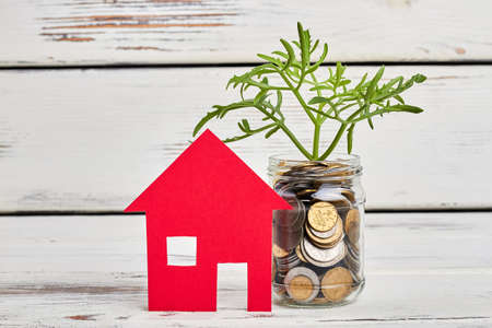 Paper house and money tree. Unlock your potential of businessman. Stock Photo