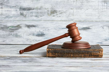 violation: Law mallet on wooden surface. Justice will prevail. Stock Photo