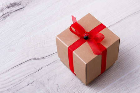 Gift Box On Wooden Plank Red Ribbon On Present Box Decorate Best How To Decorate A Gift Box
