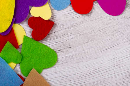 Lots of multicolored hearts. Wooden plank with colorful hearts. Lovely decorational mockup. Cute wallpaper idea. Stock Photo