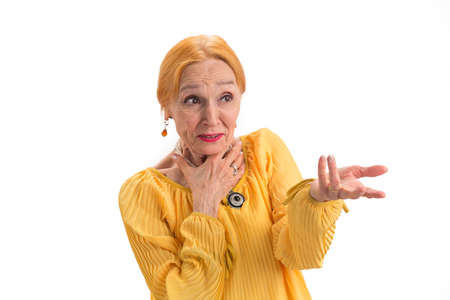 Portrait of surprised old woman. Scared lady looking aside. How to deal with fear.