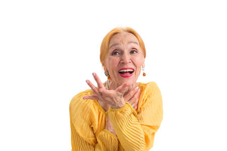 Isolated senior woman laughing. Cheerful lady on white background. Benefits of being optimistic.