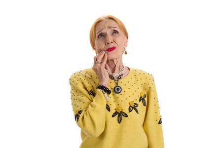 Old woman having toothache. Upset lady looking up isolated. Pain caused by gum disease. Stock Photo
