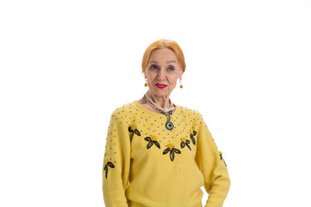 displeased: Old lady on white background. Displeased senior lady. Trust no one.