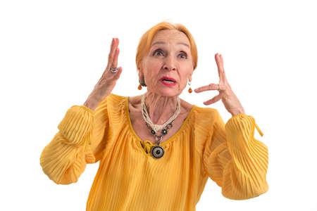 Annoyed woman on white background. Stressed senior lady. Waste of nerves.
