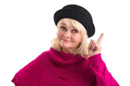 Senior lady with raised finger. Elderly woman on white background.