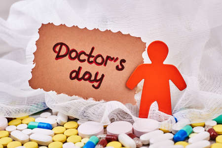 stickmen: Stickman and scattered pills. Doctors Day card for surgeon. Stock Photo