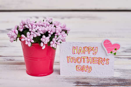 Card with heart and flowers. Gift for Mothers day. Stock Photo