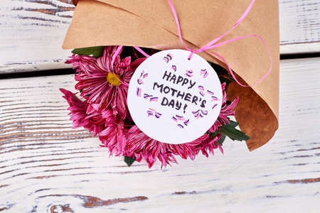 Chrysantemums on wooden background. Surprise for dear mother.