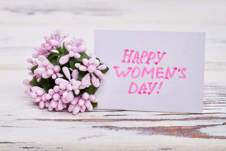 Bunch of flowers and card. Congratulation for Womens day. Stock Photo