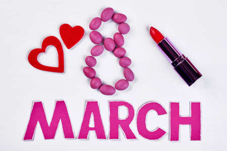 Lipstick and dragee. Simple congratulation to Womens day.