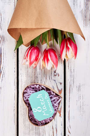 heartshaped: Bouquet of tulips and heart. Congratulation for precious woman. Stock Photo
