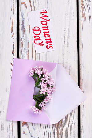 Flowers, envelope and greeting card. Congratulation from heart.