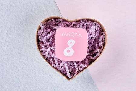 heartshaped: Greeting card and heart-shaped box. Best wishes on 8 of March. Stock Photo