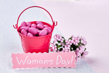 sweettooth: Bucket with dragee near flowers. Wishing you beautiful Womens day.