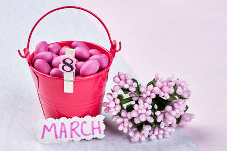 sweettooth: Bucket with sweets and flowers. Celebrate the power of womanhood.