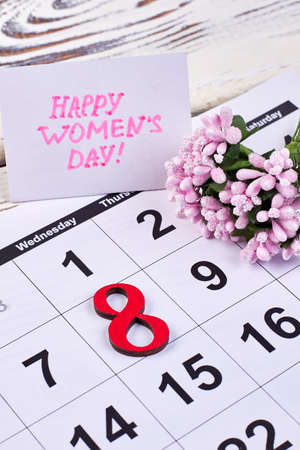 Flower and calendar on wood. Congratulation with Womens day.
