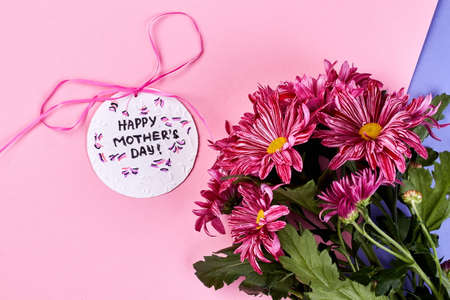 Chrysanthemums on pastel backdrop. Gift for mother from heart.