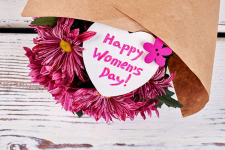 bunch of hearts: Chrysanthemums on wooden background. Present for most beautiful.
