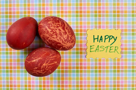 Painted red eggs. Happy Easter handmade card. Topical Easter attributes.