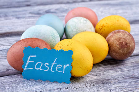 Many-colored Easter eggs. Easter handmade card. Easter topical attributes. Stock Photo
