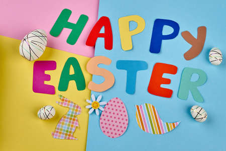 Happy Easter colorful letters. Styrofoam eggs and paper cutouts.