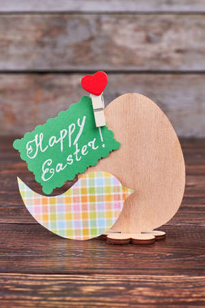 Plywood egg and Easter card. Colorful paper bird cutout. Easy and beautiful crafts. Stock Photo