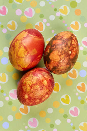 Several dyed eggs. Eggs on colorful surface. Typical Easter food.