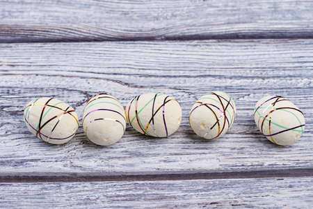 Polystyrene eggs, gray wood background. White styrofoam Easter eggs. Creative easter craft ideas.
