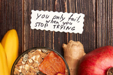 difficult lives: Natural food on wooden surface. Good results take time. Stock Photo