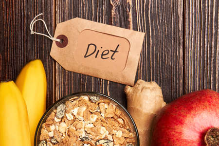 Label, muisli and fruits. Healthy balance diet. Stock Photo